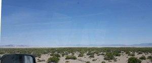 View of vehicle dust trail traveling down the Black Rock Desert Playa road.