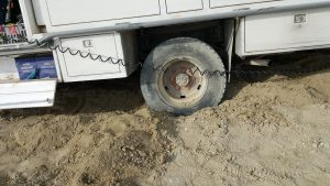 The driver side rear tire.